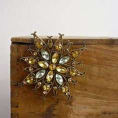 Vintage starburst pin. Would look great with layered pearls.
