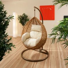 Wicker rattan hanging chair with a cozy white cushions | Wicked Wicker Furnitures