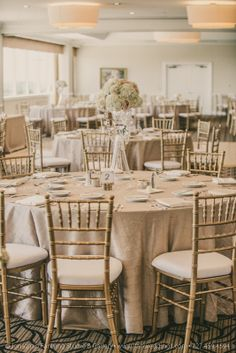 A beautiful view of our Centre Club ballroom.  Gold Chiavari chairs and Champagne Pintuck cloths.