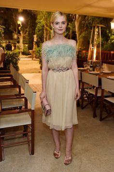 Elle Fanning in Prada attends Prada Private Dinner during the 70th annual Cannes Film Festival at Restaurant Fred L'Ecailler on May 22 2017 in Cannes France
