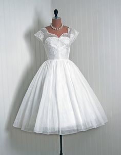 Vintage 1950's wedding dress. I prefer long wedding dresses but I'd totally wear this!