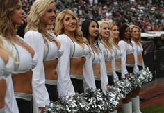 Cheerleaders line up as the Oakland Raiders prepare to take the field against the 49ers.
