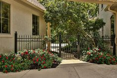 37011 Edgewater Dr Pinehurst, TX 77362: Photo Fully fenced with wrought iron, 3 gates and beautiful landscaping accents!