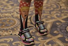 """Washington DC, US  A young supporter wears socks with the image of Republican presidential nominee Donald Trump before his press conference at the Trump International Hotel. Trump said that he would shortly release """"very, very specific"""" results of a physical examination, a day after Hillary Clinton was revealed to have pneumonia"""