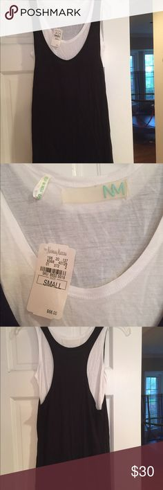 NWT Neiman Marcus layered tank top. Size S. $30 NWT Neiman Marcus brand layered tank top. Size small. Perfect length to wear w leggings or jeans. Originally purchased at Neiman Marcus for $68. Asking $30 Neiman Marcus Tops Tank Tops