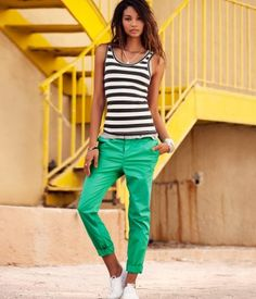 Black and white striped tank with green pants