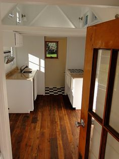 New interior of a recently completed tiny house in Missouri.  It has two sleeping lofts, one will accomodate a king size mattress and the other a twin.