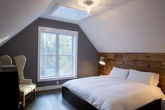 This is the Belfry – one of our two guest suites. When we restored the Schoolhouse, we enclosed the bell tower in glass to preserve the original cast-iron bell, which is suspended above this room. Bronson created the accent wall with aged pine. (walls: Benjamin Moore's Regal Select, Eggshell, Whale Gray 2134-40)