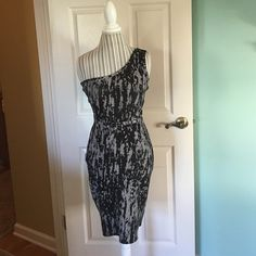 BCBG One Shoulder Dress Size L NWOT BCBG One Shoulder Dress. Size Large. Never Worn! Zipper Back. Very Soft and Stretchy Material. Would be cute with a belt and black booties! 87%Rayon 12%Nylon 1% Elastano BCBG Dresses Mini