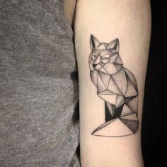 Polygon fox tattoo on the upper arm by Ivy Saruzi. Tattoo...