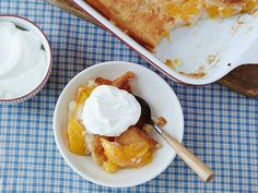 Easy Peach Cobbler Recipe : Trisha Yearwood : Food Network - Trisha uses canned peaches for this easy cobbler because they're softer, but you can use fresh peaches if they're available. Köstliche Desserts, Delicious Desserts, Dessert Recipes, Fruit Dessert, Diabetic Desserts, Pudding Desserts, Party Recipes, Fruit Recipes, Cake Recipes
