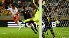 BELO HORIZONTE, BRAZIL - JUNE 22: Javier Hernandez of Mexico scores a goal past Eiji Kawashima, Atsuto Uchida and Shinji Okazaki of Japan during the FIFA Confederations Cup Brazil 2013 Group A match between Japan and Mexico at Estadio Mineirao on June 22, 2013 in Belo Horizonte, Brazil. (Photo by Laurence Griffiths/Getty Images)