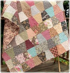 vintage style prints in this tumbler quilt - need to find a tumbler quilt pattern or tutorial