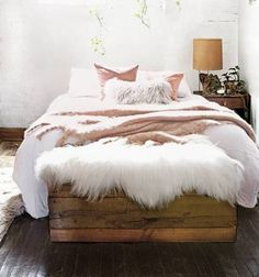 cozy bedroom with fur and shearling throws   bohemian bedroom   boho bedroom