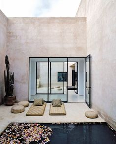 black window panes [home in Marrakesh designed by Esther Gutmer with Architect Helena Marczweski.]