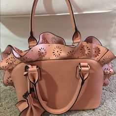 """Adorable coral ruffled laser-cut bag Zip top, one zip pocket on outside, two zip pockets and two open pockets inside.  Has shoulder strap.  Used once.  approx 9"""" high not counting ruffle x 12"""" long. Bags Satchels"""