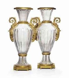 £8,000 A PAIR OF ORMOLU-MOUNTED FRENCH GLASS VASES LATE 19TH/20TH CENTURY, POSSIBLY BACCARAT Of fluted baluster form, flanked by upright acanthus-scroll handles, on a spreading foot and canted square base 31¼ in. (89.5 cm.) high (2)