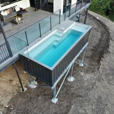Shipping Container Pools are above ground pools built from shipping containers with a fiberglass pool insert. Each pool is pre-assembled with the plumbing under the decking and with the chid safety door and stairs, you would not need any fencing. Building A Container Home, Storage Container Homes, Cargo Container, Shipping Container Storage, Container Store, Tiny Container House, Container Gardening, Shipping Container Swimming Pool, Shipping Container Home Designs