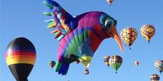 It's that time 'o year again. The Albuquerque International Balloon Fiesta kicked off Saturday in New Mexico, and hundreds of hot-air beauties have taken to the skies for nine straight days of dawn flights, night flights, concerts and (what?!)