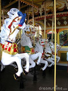 A rank of 5 white horses on this very large carousel. Posture of the outside horse is wonderful.