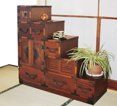 The humble Tansu embodied Japanese aesthetic ideals such as asymmetry, rusticity, and quiet elegance. These chests, some of which were also used as a staircase, have been passed down for generations.
