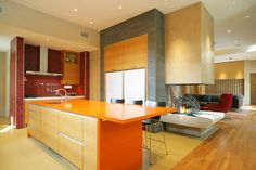 This analogous colored kitchen will create a warm and energetic environment for your family to bake in. The light yellow in the floor is analogous with the red backsplash and the orange counter-tops and the walls of the island.