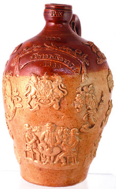 DATED HANDLED FLAGON. 10.75ins tall, brown top, lower tan salt glaze,  Impressed raised banner 'PETER KERRY', '1839' below. Raised coat of arms & 'GLASGOW' beneath that. Lots of motifs, heavy relief, all round: windmill, topers, masons symbol, ploughman, 3 gents sat round table drinking etc. Bearded face below handle to rear. Another exemplary example of its type. 05 Jul 2014 EST.£600-£800 @BBR Auctions