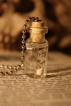 I love vial necklaces! I'm also a huge fan of hour glasses.