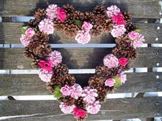 Pine cone heart wreath made with cones from Red Pine tree (some painted pale pink) and Scot Pine cones with light and dark pink silk roses. About 14 inches wide. All but the smaller cones are double wired onto a wire heart form. Very sturdy. :) I can also do a 16-inch one (roughly 18 inches wide finished) on request for $38. I do custom wreaths on request. Not recommended for outside in the rain as the flowers are secured with glue. ACCURATE SHIPPING COST GUARANTEE: Ill do my best to keep…