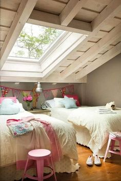 I like the off white beds with a touch of color on pillows and blankets. Love the window