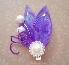 Hey, I found this really awesome Etsy listing at https://www.etsy.com/listing/100263627/on-sale-purple-peacock-hair-fascinator