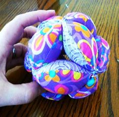 Amish puzzle ball tutorial! Perfect for the baby to grasp and it wont hurt when he whacks himself in the head with it :)