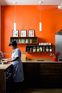 bright orange kitchen walls with dark stained cabinets | paint it