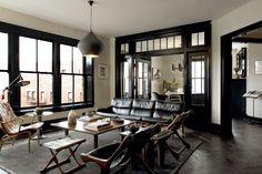 black window and door frames- cool, trendy living room space