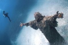Underwater Bronze Statue of Jesus Christ, Mediterranean Sea, Italy... Notice the size of the diver.