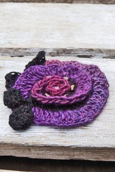 Unique rose made Freeform method. Beautiful unique design. Color use: Black, red, purple One of a kind material: acrylic, wool about diameter 16 cm/6,30 Size: One size fits all Care instruction: hand wash using warm water. I hope you enjoy! Because of different monitors and screen resolutions, colors may look different on the screen than really.