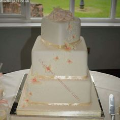 3 tier wedding cake with hand piped detail and butterflies