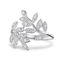"""Sterling silver bypass ring of CZ embellished leaves in a unique wrap design. Use sterling silver jewelry cleaner. Imported. STERLING SILVER is the standard for fine silver jewelry in the world over. Only Sterling Silver can be stamped with a """"fineness mark"""" of .925 indicating its high quality."""
