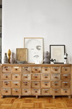 Drawer cabinet and gallery wall with neutral color palette.