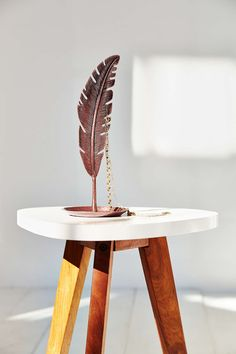 Plum & Bow Copper Feather Jewelry Stand from Urban Outfitters