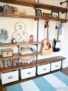 15 Fabulous DIY Plumbing Pipe Projects - Metal plumbing pipes can be used to build many amazing things, from a clothes rack to a canopy bed! Industrial Bedroom Furniture, Plumbing Pipe Furniture, Plumbing Pipe Shelves, Galvanized Pipe Shelves, Rustic Industrial Bedroom, Diy Pipe Shelves, Boys Bedroom Furniture, Diy Wall Shelves, Metal Shelves