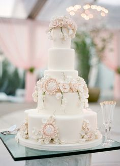 Stunning 5 tier blush colored wedding cake decorated with sugar roses and sugar proteas. Photo: http://josevilla.com/ More Great Looks Like This