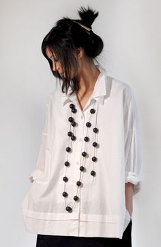 """Classic lightweight cotton white shirt with a twist. Double collar and a 1"""" tuck…"""