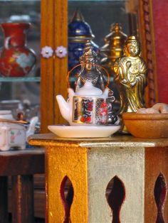 dollhouse tea pot, opium weight statues