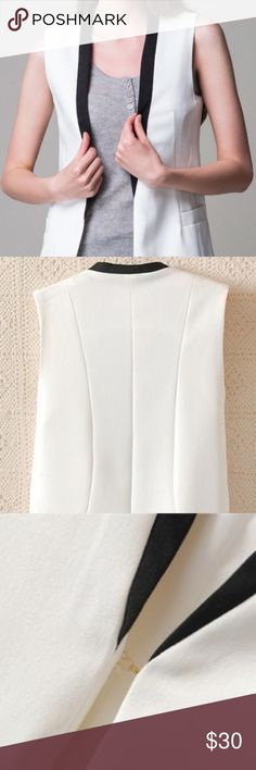 Urban Outfitters White Sleeveless Tuxedo Vest Lush White Sleeveless Tuxedo Vest with Black Lapel 🌟 Offers accepted! 🌟 Bundles accepted! 🌟 15% off 2+ items ❌ trades ❌ PayPal  **first photo is a different, but similar, item Urban Outfitters Jackets & Coats Vests