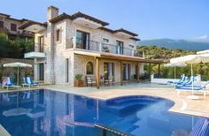 Portakal, Kas - Sleeps up to With gorgeous views of the sea and islands, a Jacuzzi in the infinity pool, and a path to sunbathing platforms at the water's edge, this understated luxury villa is ideal for idle relaxation. Luxury Villa, Holiday Destinations, Jacuzzi, Relax, Mansions, House Styles, Platforms, Beach, Islands