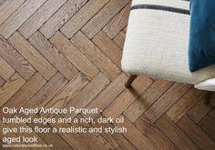 Oak Aged Antique Parquet, laid in a herringbone design.