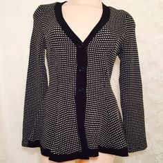 Black and white sweater. Black and white sweater. 80% Polyester 15% Rayon 5% Spandex. Sexy and stylish  this material gives you a comfortable feeling. Beautiful flare shape. Black bottons.? Finesse Sweaters Cardigans