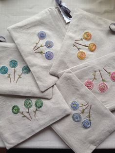 Hand made and hand embroidered pouches - a plethora of pretty ones are in the shop NOW :) www.embroiderwee.etsy.com
