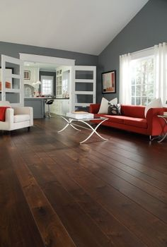 """""""Walnut Flooring"""" by Carlisle Wide Plank Flooring 701 in Sturbridge Brown Historic Stain installed over a concrete slab"""